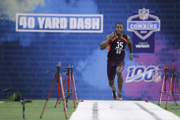Vanderbilt defensive back Joejuan Williams runs the 40-yard dash during the NFL football scouting combine, Monday, March 4, 2019, in Indianapolis. (AP Photo/Darron Cummings)