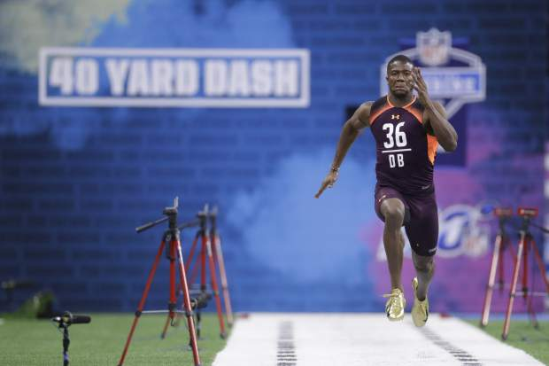 Temple defensive back Rock Ya-Sin runs the 40-yard dash during the NFL football scouting combine, Monday, March 4, 2019, in Indianapolis. (AP Photo/Darron Cummings)