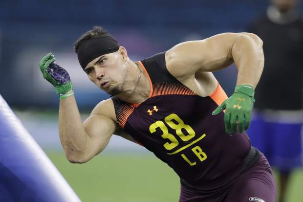 Notre Dame linebacker Drue Tranquill runs a drill during the NFL football scouting combine, Sunday, March 3, 2019, in Indianapolis. (AP Photo/Darron Cummings)