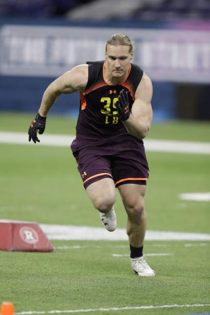 Wisconsin linebacker Andrew Van Ginkel runs a drill during the NFL football scouting combine, Sunday, March 3, 2019, in Indianapolis. (AP Photo/Darron Cummings)