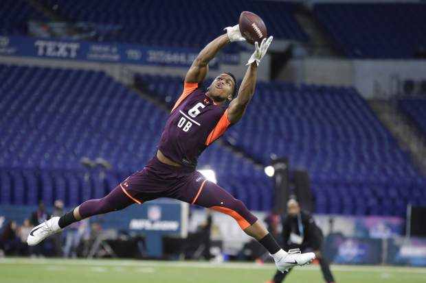 Troy defensive back Blace Brown runs a drill at the NFL football scouting combine in Indianapolis, Monday, March 4, 2019. (AP Photo/Michael Conroy)