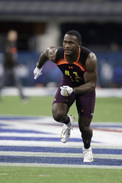 LSU linebacker Devin White runs a drill during the NFL football scouting combine, Sunday, March 3, 2019, in Indianapolis. (AP Photo/Darron Cummings)