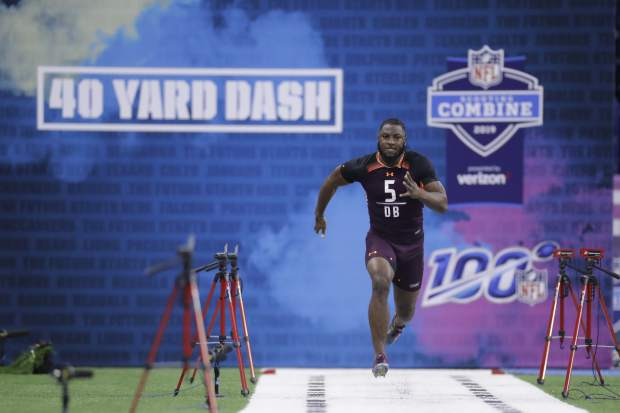Texas defensive back Kris Boyd runs the 40-yard dash during the NFL football scouting combine, Monday, March 4, 2019, in Indianapolis. (AP Photo/Darron Cummings)