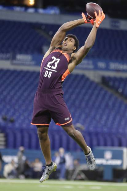 Notre Dame defensive back Julian Love runs a drill at the NFL football scouting combine in Indianapolis, Monday, March 4, 2019. (AP Photo/Michael Conroy)