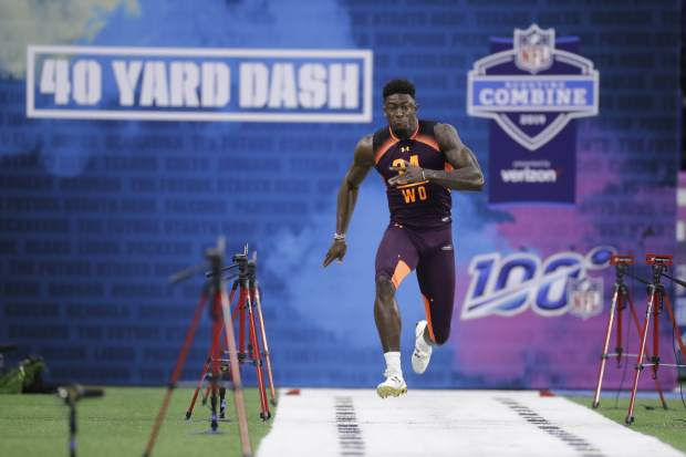 Mississippi wide receiver D.K. Metcalf runs the 40-yard dash during the NFL football scouting combine, Saturday, March 2, 2019, in Indianapolis. (AP Photo/Darron Cummings)