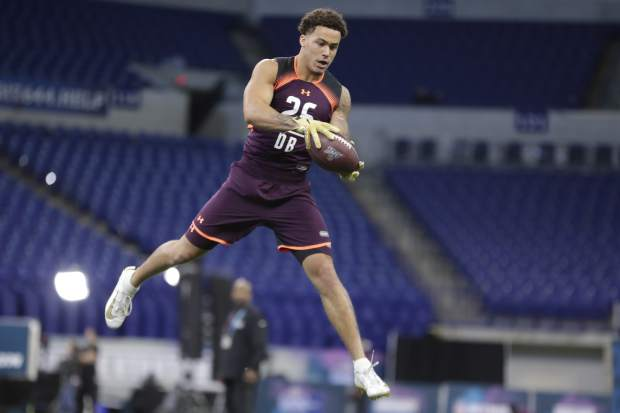 Washington defensive back Byron Murphy runs a drill at the NFL football scouting combine in Indianapolis, Monday, March 4, 2019. (AP Photo/Michael Conroy)