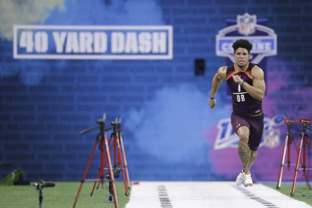 South Dakota State defensive back Jordan Brown runs the 40-yard dash during the NFL football scouting combine, Monday, March 4, 2019, in Indianapolis. (AP Photo/Darron Cummings)