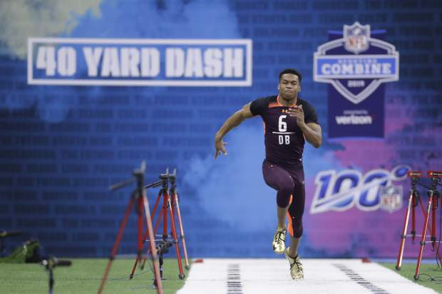 Troy defensive back Blace Brown runs the 40-yard dash during the NFL football scouting combine, Monday, March 4, 2019, in Indianapolis. (AP Photo/Darron Cummings)
