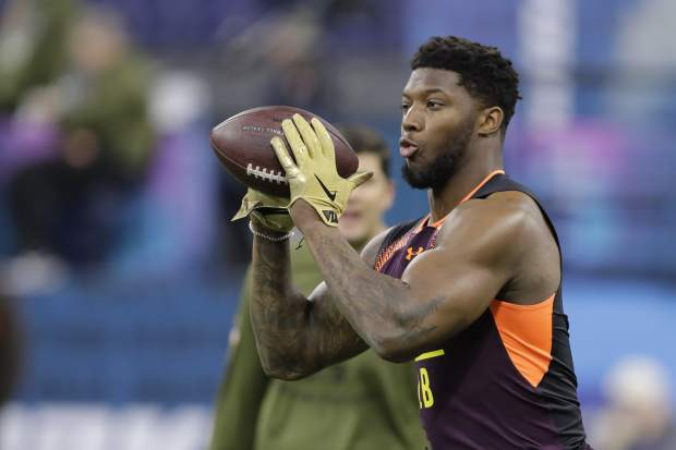 Kentucky linebacker Josh Allen runs a drill during the NFL football scouting combine, Sunday, March 3, 2019, in Indianapolis. (AP Photo/Darron Cummings)