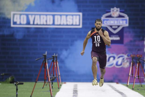 Central Michigan defensive back Xavier Crawford runs the 40-yard dash during the NFL football scouting combine, Monday, March 4, 2019, in Indianapolis. (AP Photo/Darron Cummings)