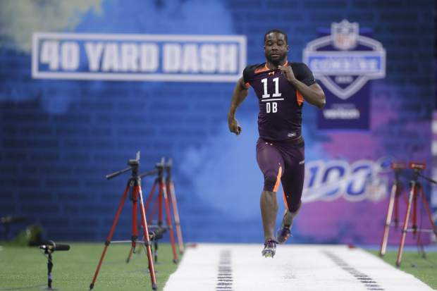 Texas defensive back Davante Davis runs the 40-yard dash during the NFL football scouting combine, Monday, March 4, 2019, in Indianapolis. (AP Photo/Darron Cummings)