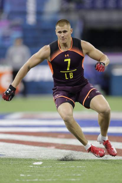 Utah linebacker Cody Barton runs a drill during the NFL football scouting combine, Sunday, March 3, 2019, in Indianapolis. (AP Photo/Darron Cummings)