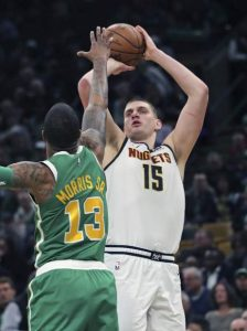 Nuggets beat Celtics, clinch playoff berth