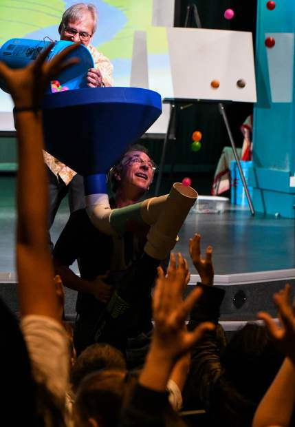 Eddie Goldstein with the Mobile Earth + Space Observatory opens up the science festival with an interactive assembly demonstrating how watersheds work during day one of the week long science festival at Carbondale Middle School.