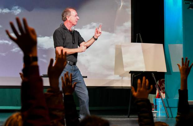Eddie Goldstein with the Mobile Earth + Space Observatory opens up the science festival with an assembly about watershed and the importance of water at Carbondale Middle School on Monday.