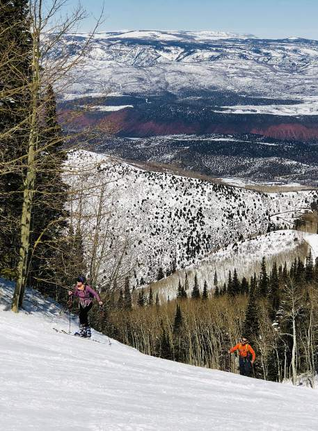 A pair of skiers skin their way up Little Max at Sunlight Mountain Resort.