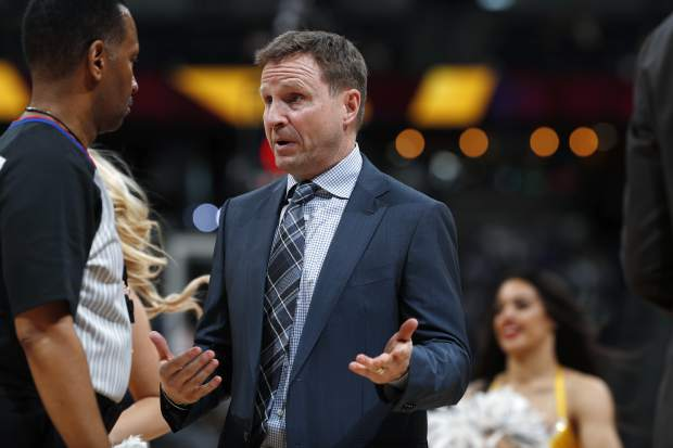 Washington Wizards head coach Scott Brooks, right, argues for a call with referee James Capers in the first half of an NBA basketball game against the Denver Nuggets Sunday, March 31, 2019, in Denver. (AP Photo/David Zalubowski)