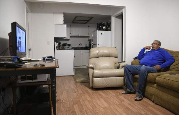 Jose Saez relaxes in his Silt apartment, enjoying a television program, before making the commute to Aspen where he works at a detox facility.