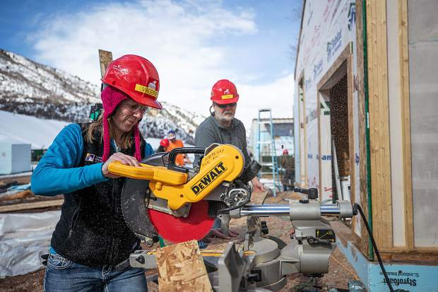 Valerie Forbes using the chop saw for construction on the Basalt Vista Affordable Housing project with Habitat for Humanity on Feb. 28.