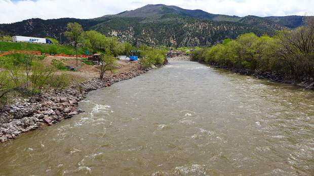 A view looking up the Colorado River from the pedestrian bridge over the river, just upstream of the river's confluence with the Roaring Fork River. The location is one of three potential locations where the City of Glenwood Springs plans to build, someday, a whitewater park with two play waves.