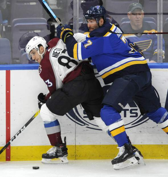 St. Louis Blues' Pat Maroon (7) battles for the puck with Colorado Avalanche's Matt Nieto (83) during the first period of an NHL hockey game, Monday, April 1, 2019, in St. Louis. (AP Photo/Bill Boyce)
