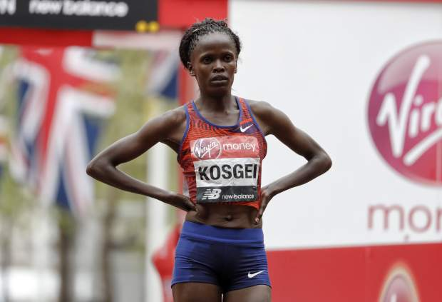 Kenya's Brigid Kosgei wins the women's race at the 39th London Marathon in London, Sunday, April 28, 2019. (AP Photo/Alastair Grant)
