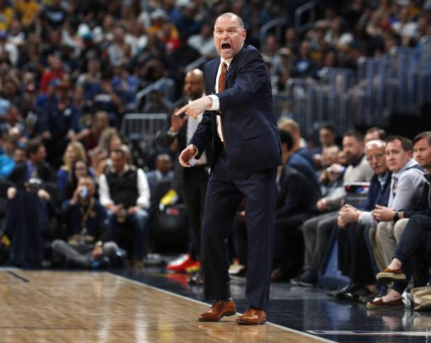 Denver Nuggets head coach Michael Malone directs his team against the San Antonio Spurs in the first half of Game 7 of an NBA basketball first-round playoff series Saturday, April 27, 2019, in Denver. (AP Photo/David Zalubowski)