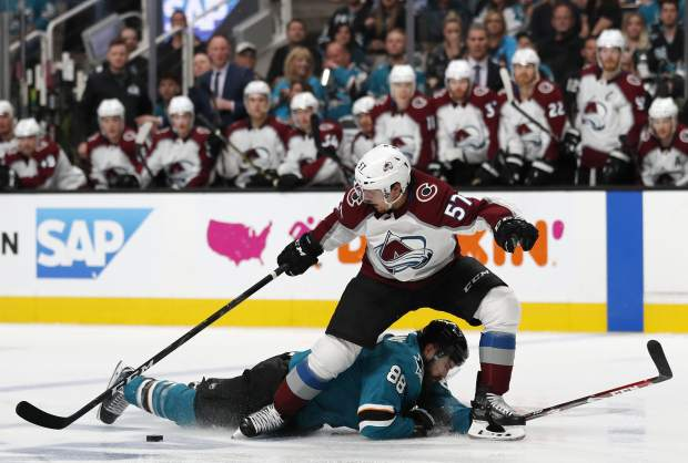 Colorado Avalanche's Gabriel Bourque (57) battles for the puck against San Jose Sharks' Brent Burns (88) in the second period of Game 2 of an NHL hockey second-round playoff series at the SAP Center in San Jose, Calif., on Sunday, April 28, 2019. (AP Photo/Josie Lepe)