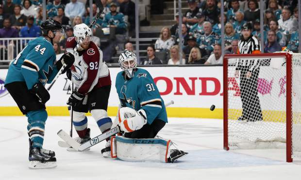 San Jose Sharks' Marc-Edouard Vlasic (44) watches as Colorado Avalanche's Gabriel Landeskog (92) scores goal against Sharks goaltender Martin Jones (31) in the second period of Game 2 of an NHL hockey second-round playoff series at the SAP Center in San Jose, Calif., on Sunday, April 28, 2019. (AP Photo/Josie Lepe)