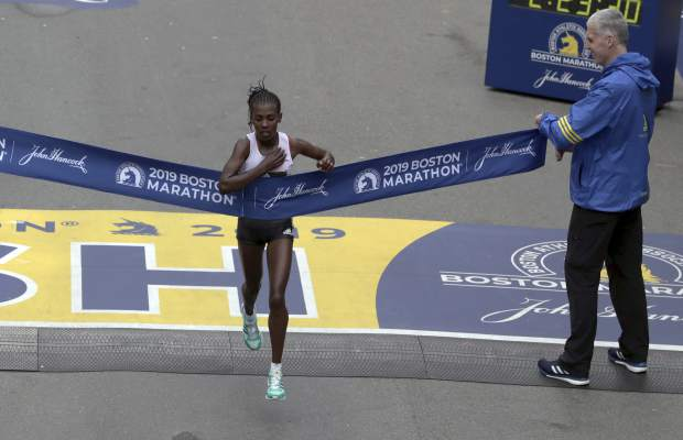 Worknesh Degefa, of Ethiopia, breaks the tape to win the women's division of the 123rd Boston Marathon on Monday, April 15, 2019, in Boston. (AP Photo/Charles Krupa)