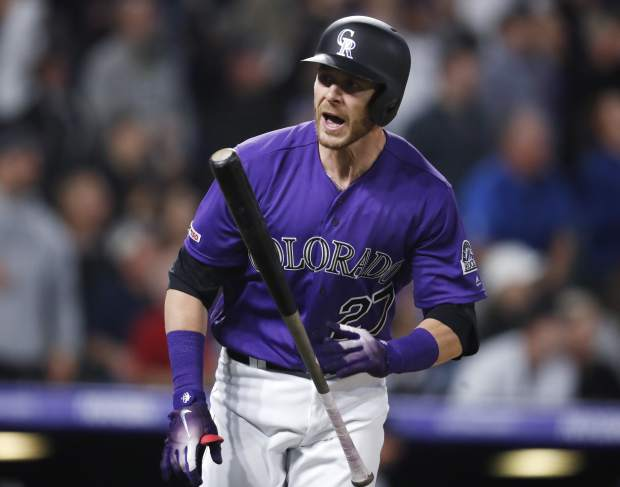 Colorado Rockies' Trevor Story flips his bat as he heads up the first base line after hitting a three-run home run off Atlanta Braves starting pitcher Julio Teheran in the fifth inning of a baseball game Monday, April 8, 2019, in Denver. (AP Photo/David Zalubowski)