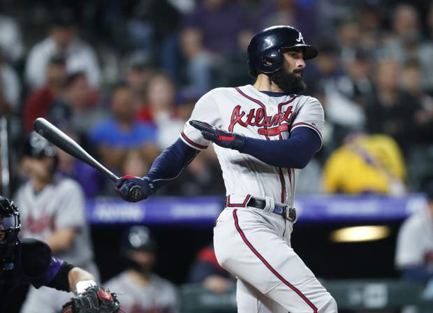 Atlanta Braves' Nick Markakis follows the flight of his single off Colorado Rockies starting pitcher Kyle Freeland in the fifth inning of a baseball game Monday, April 8, 2019, in Denver. (AP Photo/David Zalubowski)
