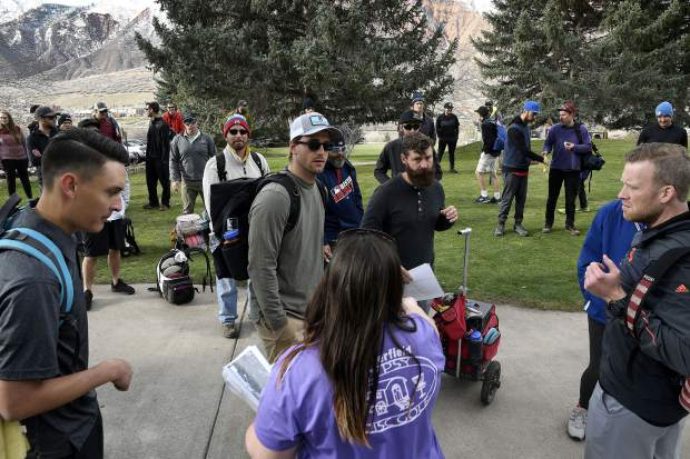 Vanessa Porterfield, tournament director, hands out score cards as competitors prepare to take to the course Saturday at Glenwood Spring Golf Club.