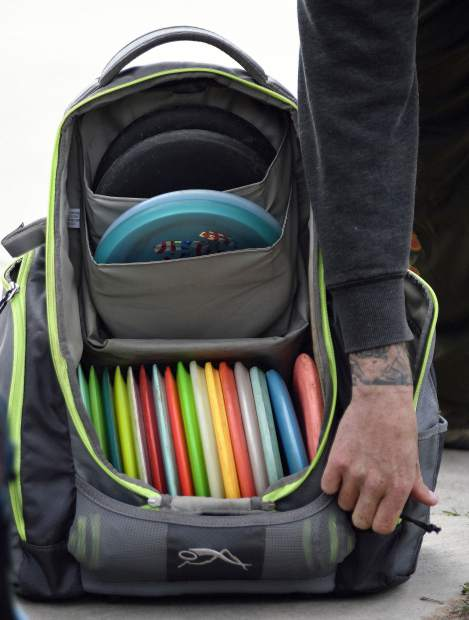 Armed with a backpack full of discs, a disc golfer prepares for the 2019 Colorado Open last Saturday at Glenwood Springs Golf Club in West Glenwood.