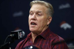 Elway evasive on quarterbacks, effusive on Harris' absence
