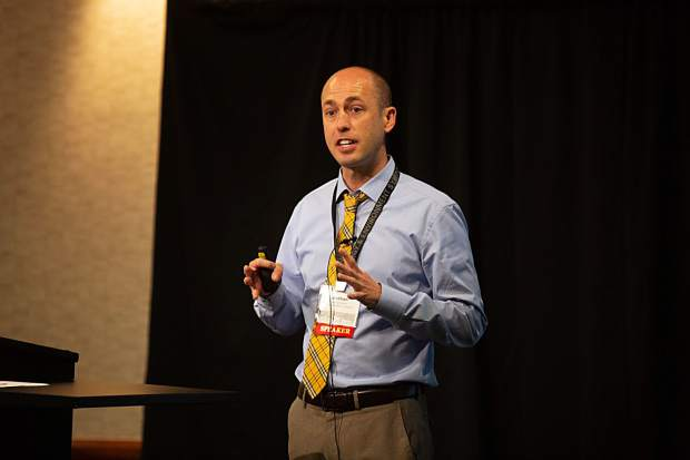 Colorado Mesa University Associate Professor of Economics Nathan Perry presented his in-depth anaylsis of the energy industry's regional contribution at the Energy and Environment Symposium in Rifle on Thursday.