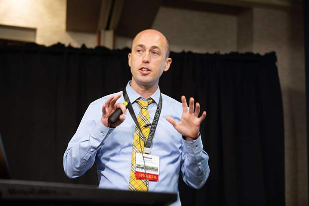 Colorado Mesa University Associate Professor of Economics Nathan Perry discussed the economic contribution of the oil and gas industry in the Piceance Basin at the Energy and Environment Symposium in Rifle on Thursday.