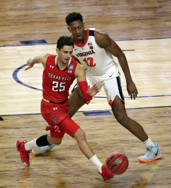 Texas Tech's Davide Moretti (25) an d Virginia's De'Andre Hunter (12) chase a loose ball during the overtime in the championship of the Final Four NCAA college basketball tournament, Monday, April 8, 2019, in Minneapolis. (AP Photo/Matt York)