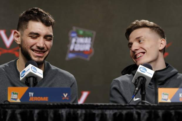 Virginia's Ty Jerome, left, and Kyle Guy laugh as they answer questions during a news conference for the championship of the Final Four NCAA college basketball tournament, Sunday, April 7, 2019, in Minneapolis. Virginia will play Texas Tech on Monday for the national championship. (AP Photo/Charlie Neibergall)