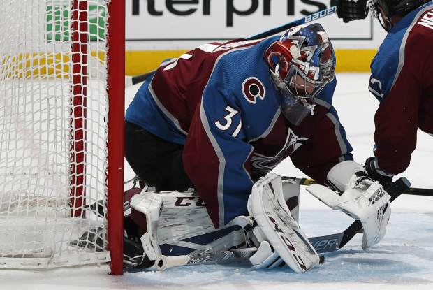 Colorado Avalanche goaltender Philipp Grubauer stops a shot against the Calgary Flames in the second period of Game 3 of a first-round NHL hockey playoff series, Monday, April 15, 2019, in Denver. (AP Photo/David Zalubowski)