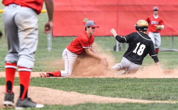 Glenwood Springs Demon Ashlon Stolley attempts to make the out at second during Tuesday's game against the Battle Mountain Huskies.