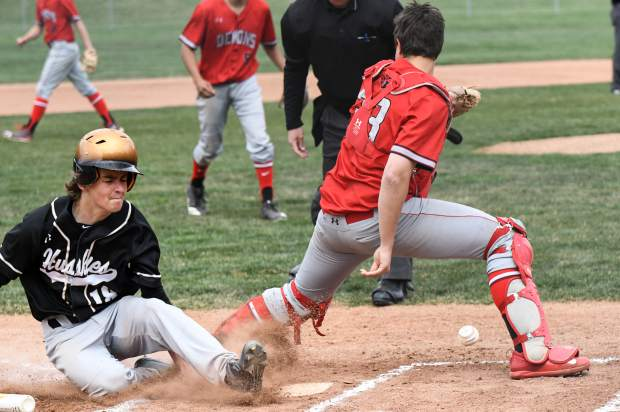 A Battle Mountain Husky gets the run at home during Tuesday's game at Glenwood Springs High School.
