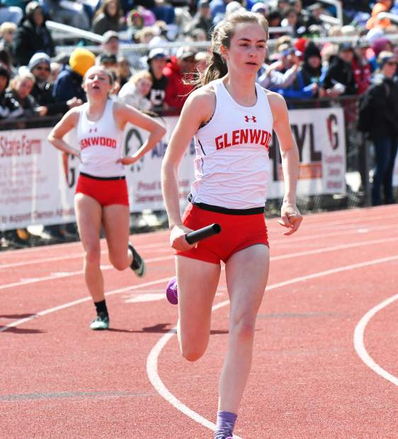 Glenwood senior Emily Worline takes off after receiving the baton from teammate Hadley Yellico in a relay event at the Demon Invitational Saturday.