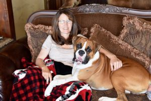 Rifle rallies to find lost dog after car wreck
