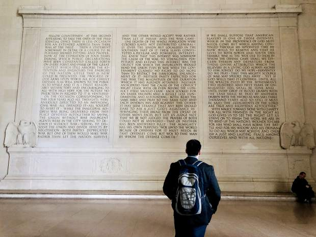 A visitor to the Lincoln Memorial reads Lincoln's speech during his second inaugural address that is carved into the marble interior walls. The marble to construct the memorial was quarried in Colorado.