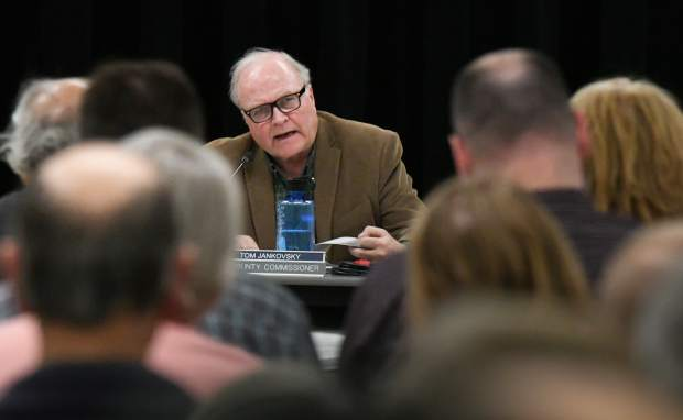 Garfield County Commissioner Tom Jankovsky raises questions during a presentation by representatives of Rocky Mountain Resources at a public meeting held at Glenwood Springs Middle School on Monday evening.