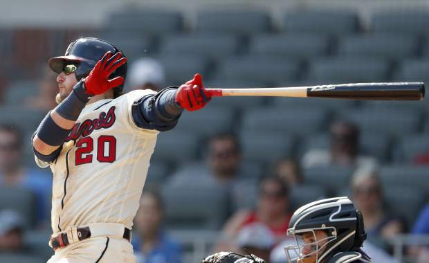 Atlanta Braves third baseman Josh Donaldson (20) follows through on a three-run home run in the eighth inning of a baseball game against the Colorado Rockies Sunday, April 28, 2019, in Atlanta. The Braves won 8-7. (AP Photo/John Bazemore)