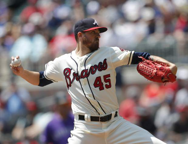 Atlanta Braves starting pitcher Kevin Gausman (45) works in the first inning of a baseball game against the Colorado Rockies Sunday, April 28, 2019, in Atlanta. (AP Photo/John Bazemore)