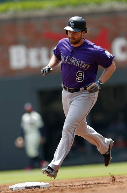 Colorado Rockies' Daniel Murphy (9) rounds second base after hitting a home run in the third inning of a baseball game against the Atlanta Braves, Sunday, April 28, 2019, in Atlanta. (AP Photo/John Bazemore)