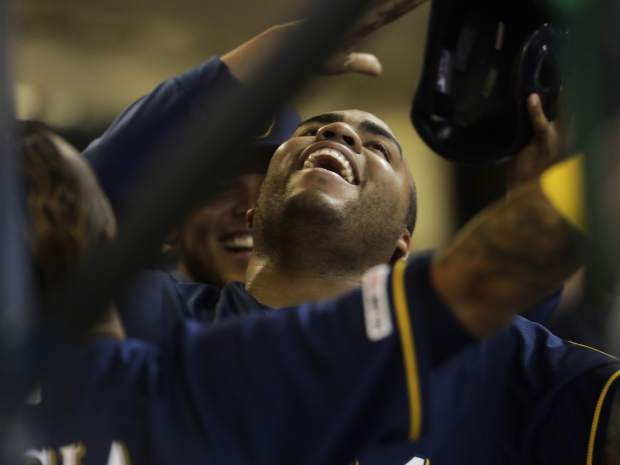 Milwaukee Brewers' Jesus Aguilar celebrates his three-run home run during the first inning of a baseball game against the Colorado Rockies Monday, April 29, 2019, in Milwaukee. (AP Photo/Morry Gash)